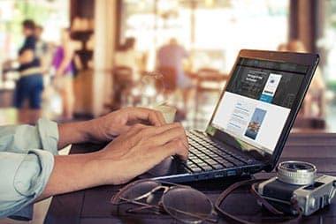 man working on laptop in bar