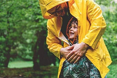 dad and child in the rain in coats